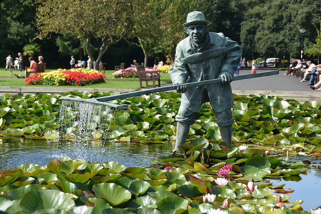 Statue of a shrimper in the pond at Lowther Gardens