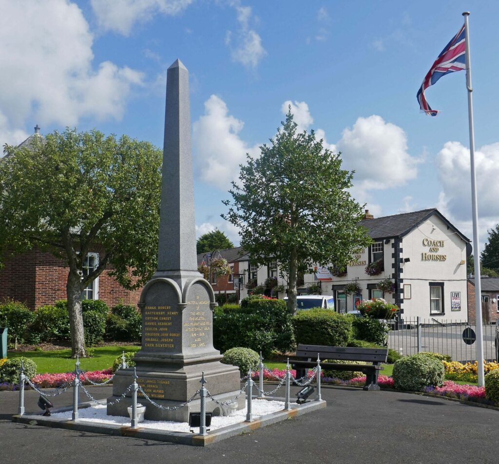 Freckleton village cenotaph and Coach and Horses pub. Photo: Sue Massey